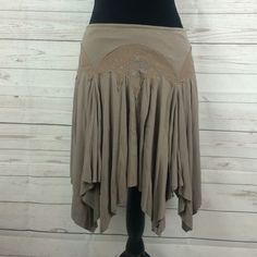"Free people asymmetrical skirt Free people asymmetrical skirt Sz L 95% rayon 5% spandex  19"" long Free People Skirts Asymmetrical"