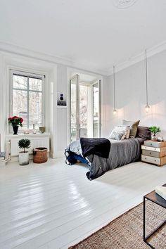 Dans une chambre, le parquet a été peint en blanc