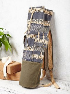 Cobra Yoga Bag | Printed cotton yoga bag featuring outside storage pockets with snap closures. Inside zip pocket. Adjustable drawstring and adjustable straps. *By Free People