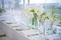 style me pretty - real wedding - usa - massachusetts - nantucket wedding - the white elephant - reception decor - table decor - centerpiece - amaryllis & dendrobium orchids