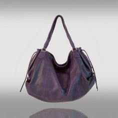 Olivia: A large classic tote with lovely detailing. Double handles, envelope side closure with Italian golden hardware including golden dog clips, and magnetic closure. Slouchy soft deerskin, yet stylish and utterly fashionable. $330