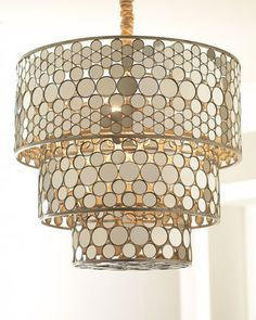 "Three-Tiered Chandelier - Neiman Marcus  Exclusively ours. A handcrafted wrought-iron frame is inlaid with hundreds of mirror-finished acrylic disks in this striking chandelier. Imported.  Frame has a hand-painted finish.  Uses five 60-watt bulbs.  Professional installation required.  28""Dia. x 28""T with a 10'L chain; ceiling canopy included."