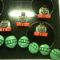 Thomas the train cupcakes made for my nephew. Oreo & sugar wafers dipped in colored icing. Used icing also to draw the rest of his features. fun!