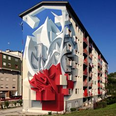 3D Graffiti on the side of a building in Campobasso Italy by artist Peeta.