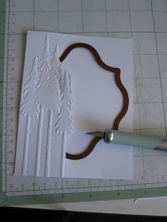 Cutting out a partial window behind embossing - brilliant! Links to tutorial.