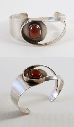 Cuff | Henry Steig.  Sterling silver and carnelian #BestJuicerRecipes #SterlingSilverBangles