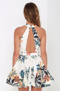 With the ocean nearby and a hula tune on the wind, the Lahaina Luau Ivory Floral Print Skater Dress will feel right at home! A bold botanical print makes its way across woven ivory fabric with shimmering gold threading throughout. Halter neckline fastens with two gold buttons behind the neck, while a paneled bodice and back leave sexy vertical cutouts. Skater skirt spays out from a banded waist and ends in a voluminous structured hem. Exposed gold back zipper. Bodice is lined. 100%…
