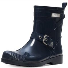NWOT COACH MID CALVE RAINBOOT NO TRADES BRAND NEW NEVER WORN.  NO BOX.  AVAILABLE IN NAVY BLUE (size 7).  Rubber boot texture with metal Coach label/tag. Coach Shoes Winter & Rain Boots