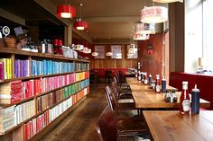 The Laundromat Café in Reykjavik, Iceland. Those books go all the way around the bar in the middle of the room. [Photos via]