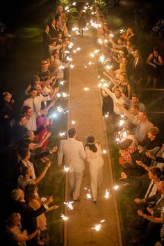Gorgeous Wedding Sparklers to adorne this uniuqe evening wedding ceremony aisle with burlap, creative country wedding theme you can have a try.