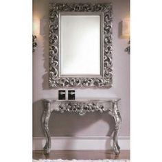 Speil med ramme i tre og overflate i børstet sølv. $3,750.00
