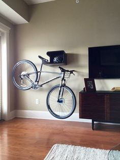 Modern indoor bike rack that looks great with or without bike. Combining sleek design with perfect function. Available in grey, granite white or black. Includes all the hardware and a black felt pad f Hanging Bike Rack, Indoor Bike Rack, Bike Hanger, Bicycle Storage, Bicycle Rack, Bike Storage Apartment, Bike Wall Mount, Bike Storage Solutions, Range Velo