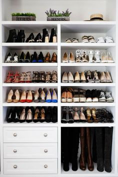 Back wall: Floor to ceiling shoe shelves in center. Halfway up drawer units on…