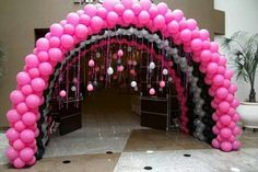 Hot pink, black and silver entrance arch