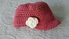 Women's brimmed hat with cream rose accent!