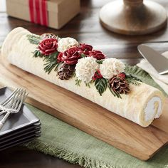 A Yule log, or French Bûche de Noël, is a traditional dessert served at Christmas, and may appear to come straight out of the forest. Our version is a bit fancier, covered in ivory-tinted icing and decorated with icing roses, carnations, pine and holly. Serve this holiday-worthy dessert as a spectacular end to your Christmas Day celebrations!