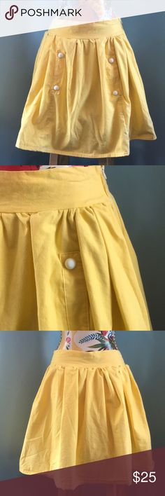 """Handmade vintage yellow skirt Adorable vintage skirt in butter yellow. White textured decorative buttons on either of the two slit pockets. In EVC, cotton, side zip and fully lined in white cotton.   Waist is 14"""" flat.   19.5"""" long.   All items ship promptly from my cat-friendly, non-smoking home. I welcome questions. I do not welcome lowballers. Vintage Skirts"""