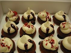 Red Velvet cupcakes with blood splatters.  Something tells me True Blood or Dexter party!