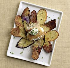 Fingerling Potato Galettes with Chive Crème Fraîche and Smoked Trout--This elegant starter takes fish and chips to a whole new level. via FineCooking.com