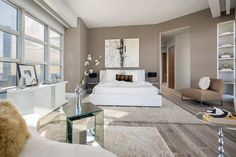 Contemporary Master Bedroom with High ceiling, Hardwood floors, Built-in bookshelf, Carpet