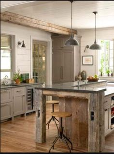 Love this kitchen! No upper cabinets? Nice!