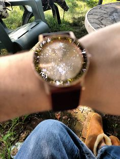 The camera focused on the reflection of the tree instead of the watch.