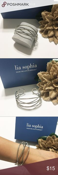 Cuff Bracelet Rhodium plated with one of a kind design. Does not tarnish. It has been used but still in a perfect condition. Does not come with a box. Lia Sophia Jewelry Bracelets