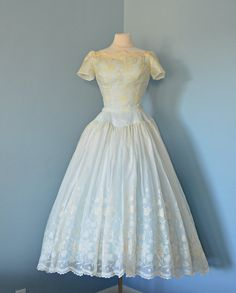 Vintage 1950s Wedding Dress...Beautiful Ivory Silk Organza CAHILL LTD Ballerina Length Wedding Dress Medium. $425.00, via Etsy.