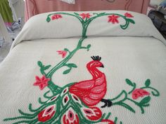 Red pink and green peacock chenille bedspread, via Etsy. Shut up and take my money!!