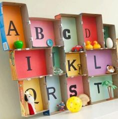 alphabet boxes with relevant found objects