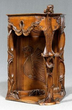 Art Nouveau Corner Cabinet: fruitwood throughout, carved devil finial, floral and foliate decoration and relief carved dragon, paneled back, pegged construction, Continental, possibly Italian, late 19th century, 34-1/2 x 26 x 17-1/2 in.
