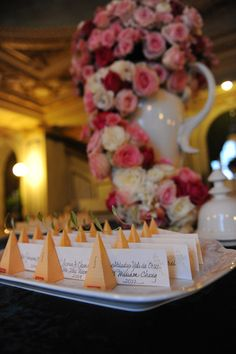 Place cards attached to individual Tea Forte infusers for Old English tea party wedding | Photo: Unique Design Studios