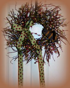 "Love the colors in this pip berry wreath it is perfect for the season all the way through Summer....Green, Light Purple, Cream and    Red....Pip Berries with Ladybug Ribbon and Mr. Bumblebee . 26"" across and 30"" length with ribbon.. $32.99"