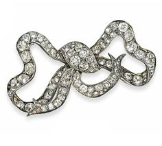 A LATE 19TH CENTURY DIAMOND BOW BROOCH  Of undulating form, the pavé-set old-cut diamond knot to similarly-set loops and ribbons, mounted in silver and gold, circa 1880, 5.1cm wide