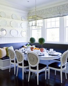 cobalt blue banquette for a full-size dining table in a kitchen by Leeann Thornton