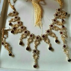 sale New Jewlery set I have never worn it. Beautiful necklace with earing. ruby and zirconia like stones Accessories