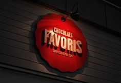 Really nice Branding job. Chocolats Favoris by Backlit Signage, Window Signage, Wayfinding Signage, Signage Design, Graphic Design Branding, Cafe Design, Branding Jobs, Commercial Signs, Outdoor Signage
