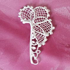 Filigree can be made with royal icing, white chocolate or sugar.