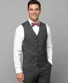 Groomsmen in grey dress pants, grey vests, pink ties. Groom in ...