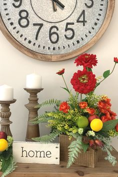 In this video tutorial, learn to make a rustic summer garden arrangement for your home or Etsy shop. This arrangement uses artificial flowers and greenery! #arrangement #decor #fruit #zinnias #farmhouse
