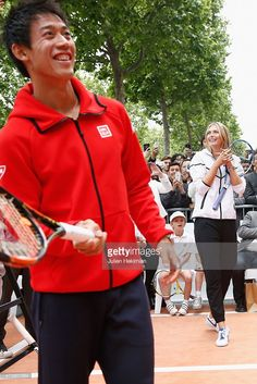 Japanese tennis player Kei Nishikori and Russian tennis player Maria Sharapova participate to the Association Theodora fund event organized by Tag Heuer on May 18, 2015 in Paris, France.