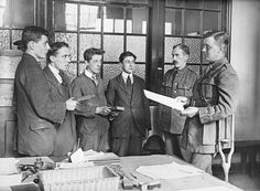 If successful in the various tests, new volunteers had to make a solemn promise to do their duty. In a ceremony led by recruiting officers, new soldiers swore an oath of allegiance to the king upon a Bible. But, with so many men eager to join up, the process was often rushed. Sometimes men were asked to recite the oath simultaneously in groups to speed the process up, as seen in this photograph - They look so young