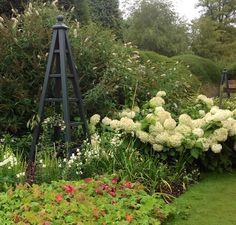 Large wooden garden obelisks in the Monks Garden at Highclere Castle