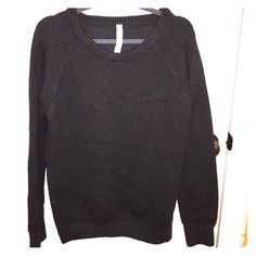 Dark Gray Lululemon Yin to You Sweater Super comfortable and cute dark gray Lululemon Yin to You sweater. Tried on and cut tag off but then never wore. It is in perfect condition. No pulls! This is a size 12 but can fit any size depending how baggy/tight you want your sweater to fit. I am normally a size 4 in lulu but have a black size 12 and wear it all the time it is just baggy/longer on me. NWOT. No longer made by Lululemon lululemon athletica Sweaters Crew & Scoop Necks