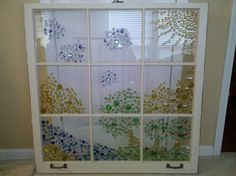 Glass flat back beads glued to an old window