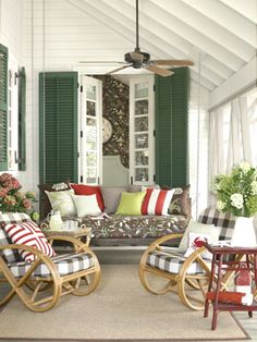 love the rockers and variety of throw pillows.  thinking screened in porch...