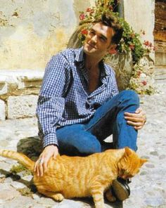 Morrisey with a tabby that looks just like Becca's kitty Charles.