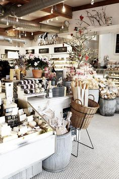 This shop is filled to the brim with product and yet it still looks clean and organized. By using neutral containers and shelving the eyes aren't overwhelmed and the products can shine through in this space.