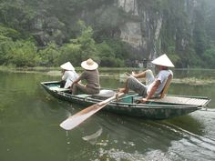 Tam Coc ~ Vietnam (boatmen use feet to paddle boat)