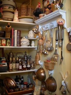 Small kitchens have to make the best use of every square inch... This is a little cluttered for me, but I like the idea of hanging the colanders on the wall.